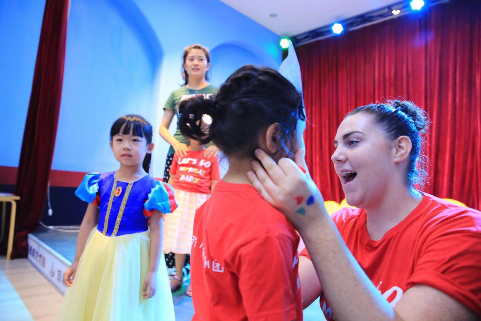 Rose teaching a drama class in China.