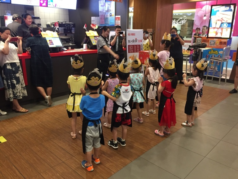 Children wearing paper crowns in a Burger King in China.