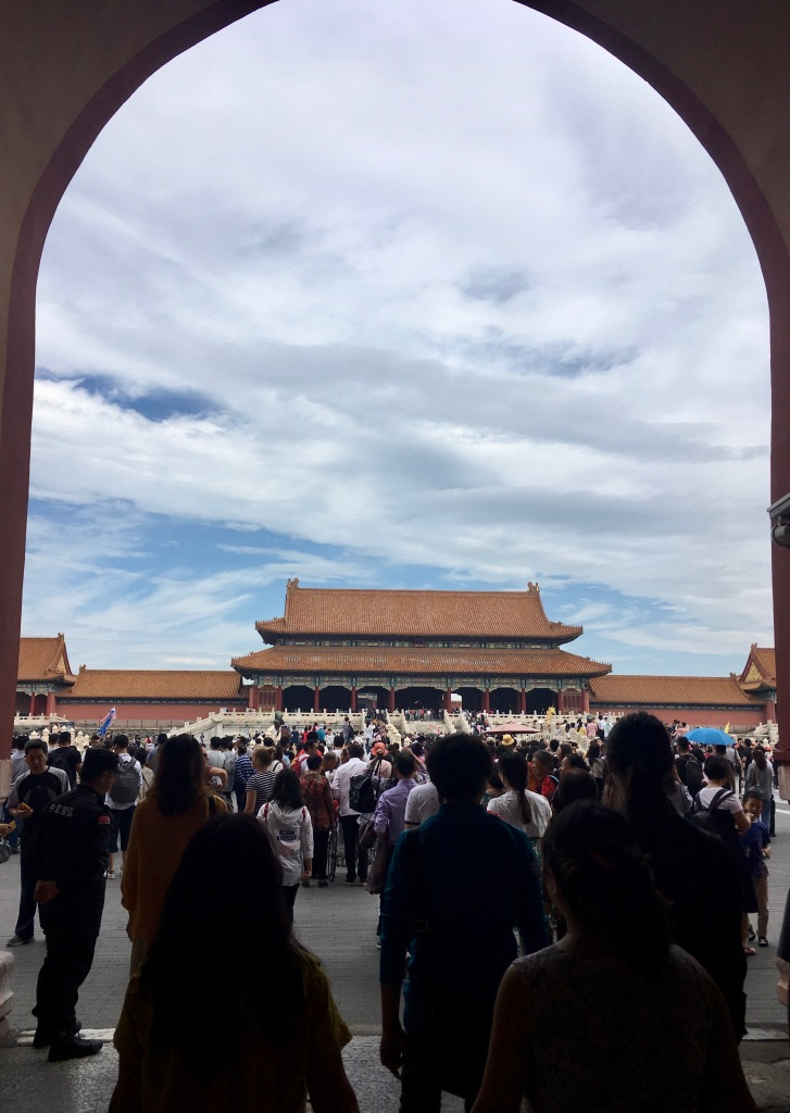 A large group of tourists entering the Forbidden City.