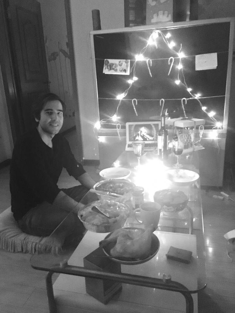 Adam and Christmas dinner in China. Black and white.