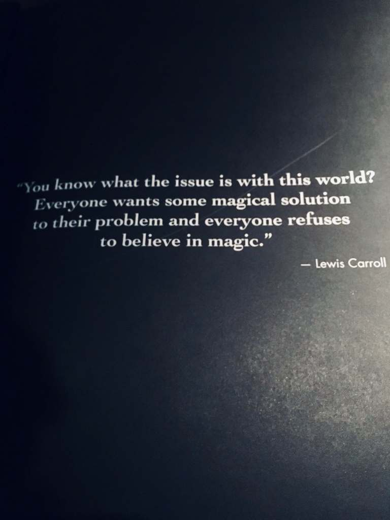 Famous quote by Lewis Carroll about believing in magic. Black background.